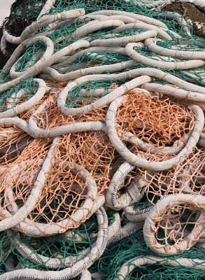 1989824-a-pile-of-nets-thrown-from-a-fishing-boat